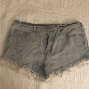 Free people denim shorts with lace detailing